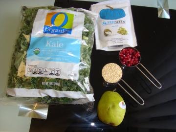 Kale, pomegranates, pumpkin seeds, and a pear