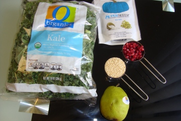 Kale, pomegranates, pumpkin seeds, and a pear