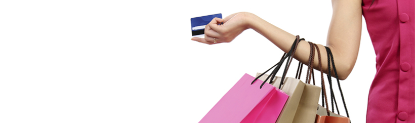 Tricks to keep you fashionable and your bank account happy - Woman on shopping spree