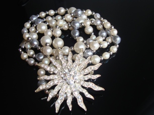 Pearl necklace and star pin