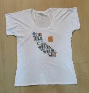 Education is Freedom: White scoop neck shirt with state of CA made out of books