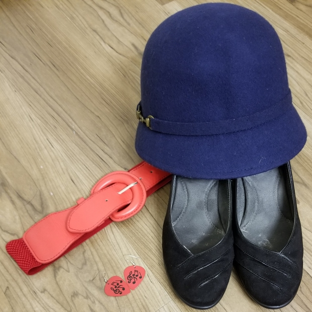 Red belt, guitar pick earrings, blue hat, black shoes